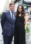 Robert Simonds and a pregnant Mila Kunis at Nasdaq