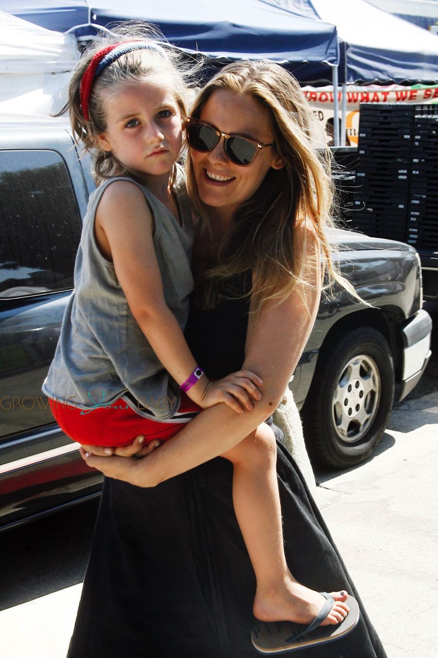 Alicia Silverstone with son Bear Blu Jarecki at the farmer's market in LA