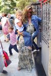 Gisele Bundchen leaves a restaurant at the Jardim Botanical Gardens with her kids Vivian and Benjamin