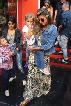 Gisele Bundchen leaves a restaurant at the Jardim Botanical Gardens with her kids Vivian and Benjamin