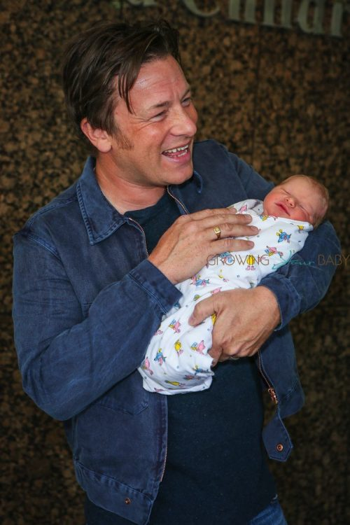 Jamie Oliver Craddles his baby boy outside the hospital