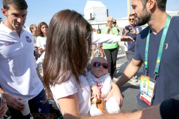 Michael Phelps and fiance Nicole Michele Johnson with son Boomer Phelps in Rio