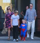 Reese WItherspoon and Jim Toth with sons Deacon and Tennessee at church