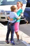 Seraphina Affleck tries to carry her brother Sam into Chruch
