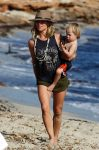 elsa-pataky-at-the-beach-in-spain-with-one-of-her-twins