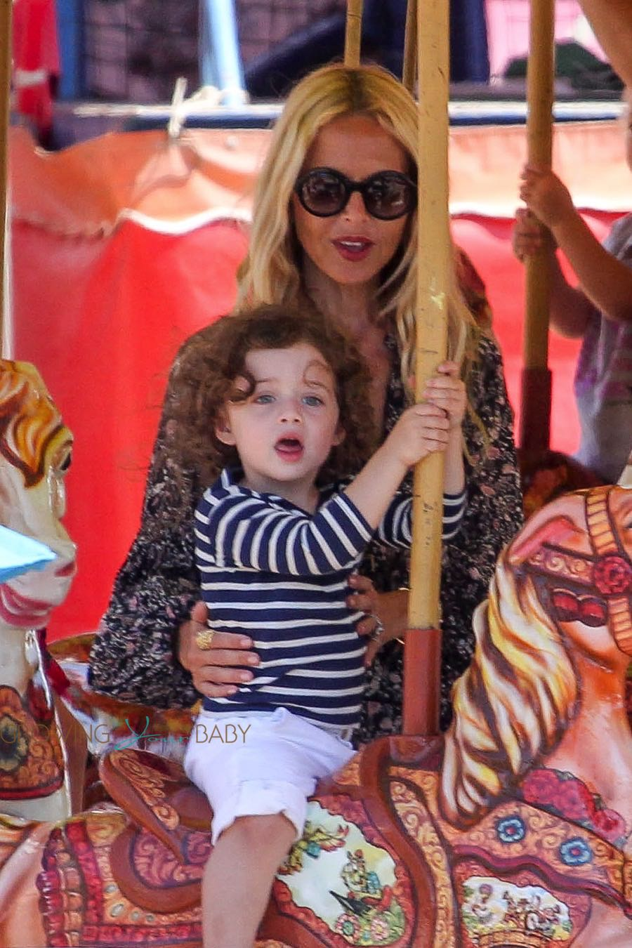 Rachel Zoe with son Kai on the carousel at the malibu Chili Cook out