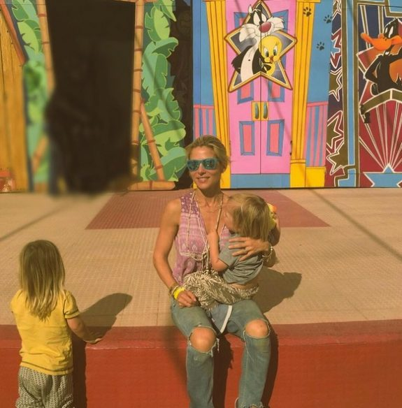 Elsa Patacky at warner bros amusement park in Spain with her kids