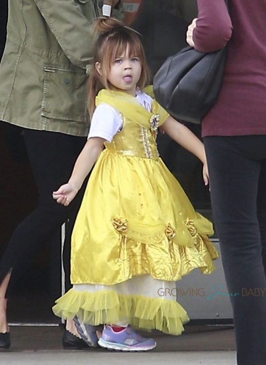 Everly was wearing a yellow Disney princess dress while out with her mother.