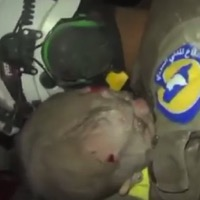 Rescuer Sobs As He Pulls Syrian Baby From The Rubble
