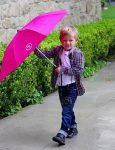 samuel-affleck-braves-the-rain-to-get-to-church