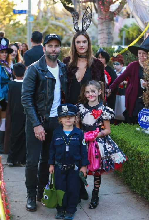 Alessandra Ambrosio and Jamie Mazur posed for photos with their kids Anja and Noah as they collected some treats In Santa Monica.