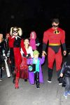 A classic Harley Quinn, Fergie and Incredibles dad Josh Duhamel were spotted taking their little joker Axl out for Halloween.
