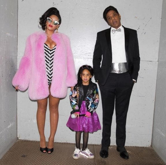 Jay-Z and Beyonce dress as ken and barbie with daughter Blue Ivy