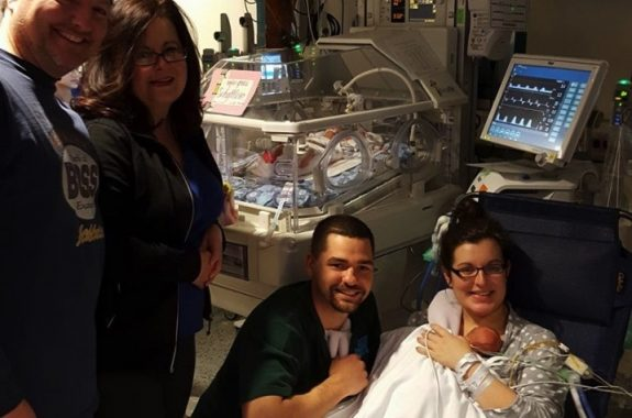 Lucas and Katie Schaftlein celebrate the Nov. 11 arrival of quintuplets with family.