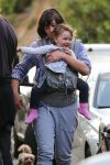 Milla Jovovich takes a Saturday afternoon stroll with her daughter Dashiel