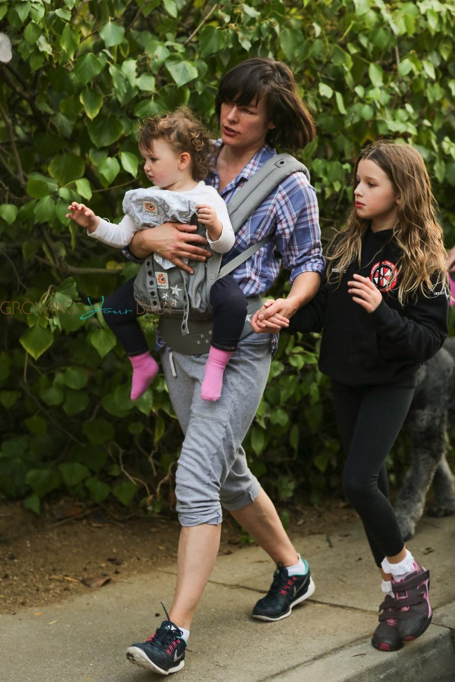 Milla Jovovich takes a Saturday afternoon stroll with her husband Paul W. S. Anderson and their two children Ever and Dashiel - William N Kate Wedding