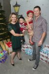 beverly-mitchell-and-michael-cameron-with-kids-hutton-and-kenzie-at-the-6th-annual-santas-secret-workshop