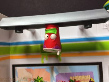 Grossery Gang - yucky mart - character hanging from the lights