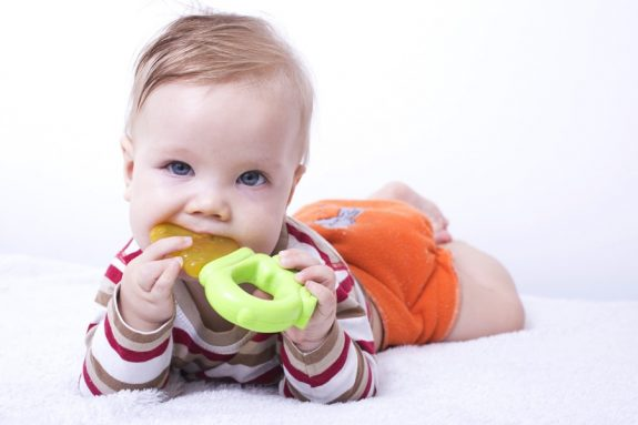 Infant with the teether