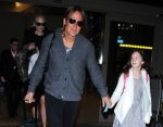 Keith Urban & daughter Sunday Rose Touch Down At LAX