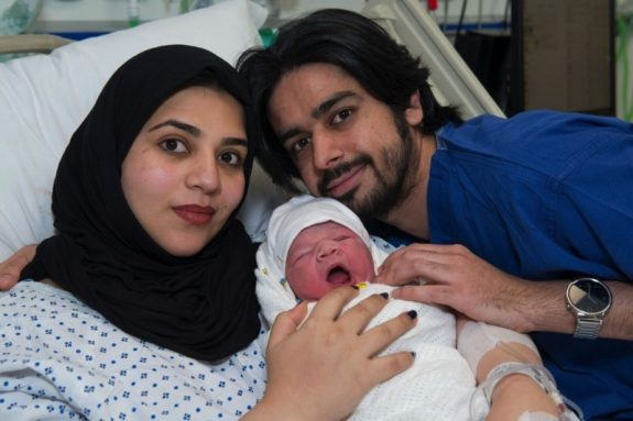 Moaza al Matrooshi with her husband, Ahmed, and their newborn baby, Rashid