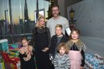 pregnant-tori-spelling-and-husband-dean-mcdermott-attend-the-6th-annual-santas-secret-workshop-with-kids-liam-stella-hattie-and-finn