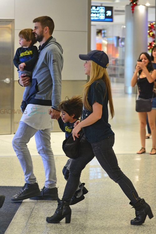 Shakira and Gerard Pique arrive at the Miami airport with their kids