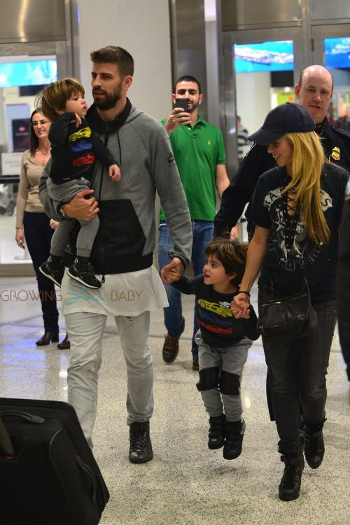 Shakira and Gerard Pique arrive to Miami airport with their kids