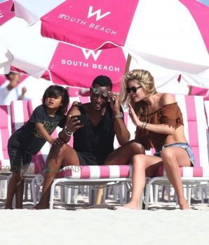 Doutzen Kroes, Sunnery James and Phyllon Gorre at the beach in Miami