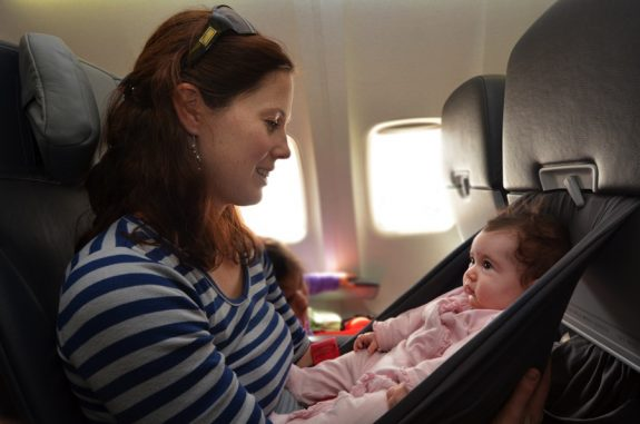 Mom and baby on airplane