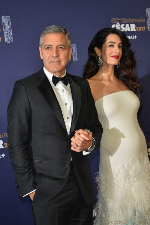 George Clooney and a pregnant Amal Clooney attend the photocall for Caesar's Film awards looking elegant together.