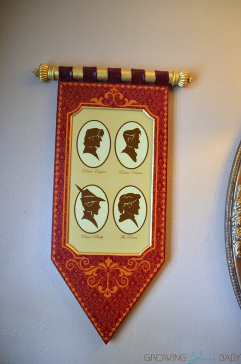 WDW Port Orleans Riverside Royal Room - prince's scroll wall