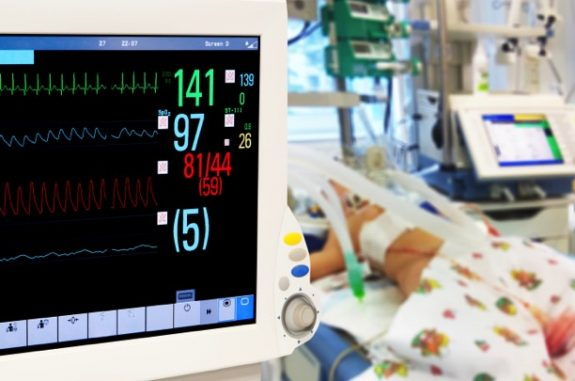 Baby in NICU with monitors