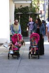 Petra Stunt and Tamara Ecclestone go for a stroll with their daughters