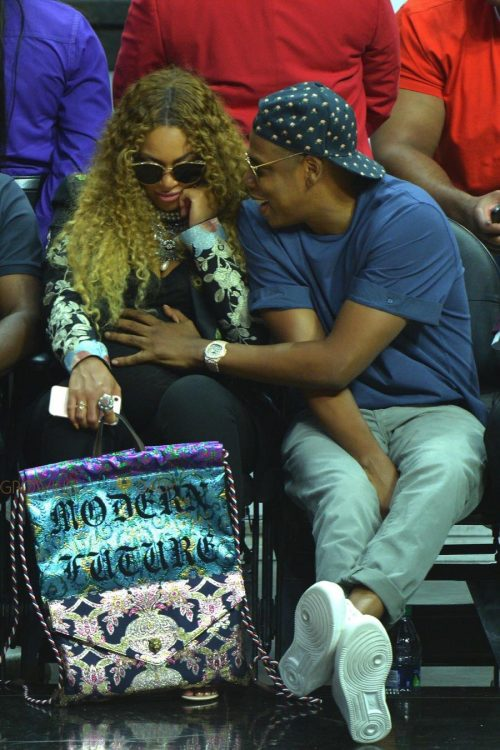 A very pregnant Beyonce and Jay Z sit courtside at the Clippers game