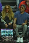 A very pregnant Beyonce and husband Jay Z sit courtside at the Clippers game
