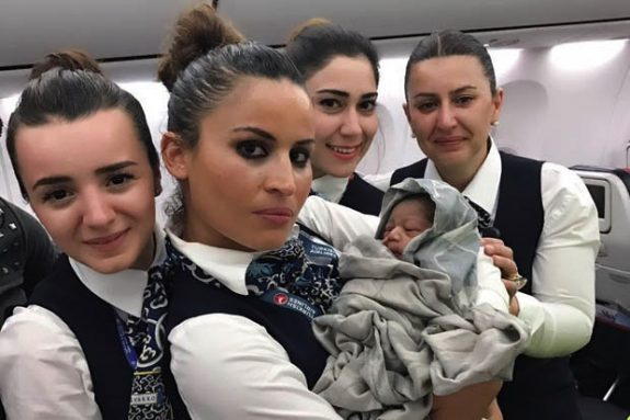 Airline crew help woman give BIRTH in mid air at 42,000ft