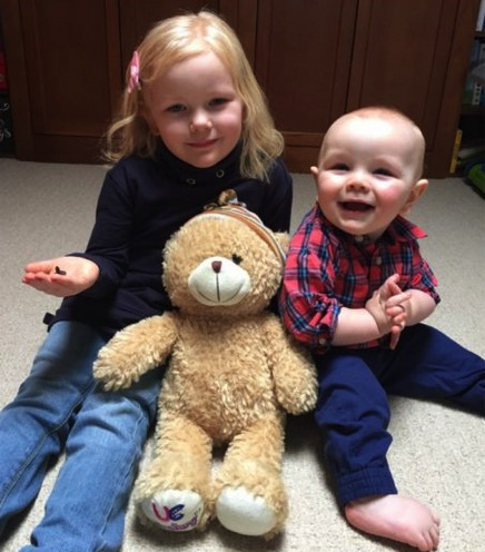 Carly and Dru White, with the bear with one of the plastic eyes missing