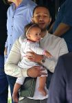 John Legend And Chrissy Teigen Take Their Luna To A Party In Bel-Air