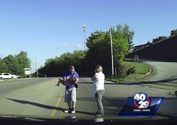 Paramedic helps after Little girl falls out of back of Bus