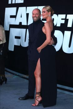 Pregnant Rosie Huntington-Whiteley and Jason Statham pose at the premiere of 'The Fate Of The Furious'