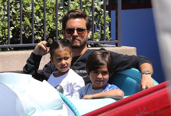 Scott Disick at DIsneyland with North West and Mason