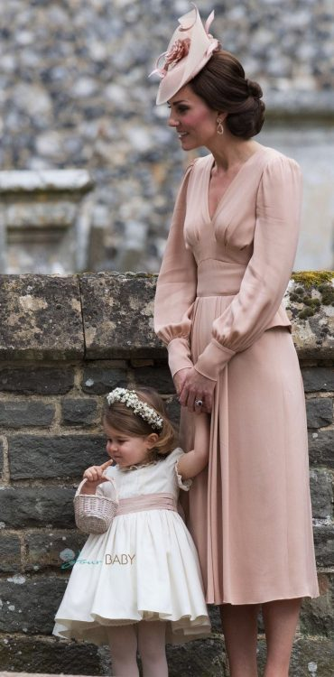 Kate Middleton and Princess Charlotte at the wedding of Pippa Middleton and James Matthews at St Mark's Church Englefield in Berkshire