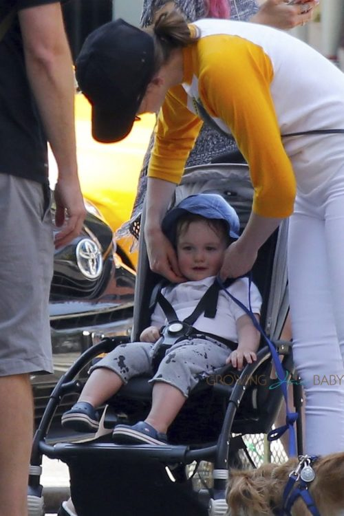 Anne Hathaway and her son Jonathan take their pooch for a stroll