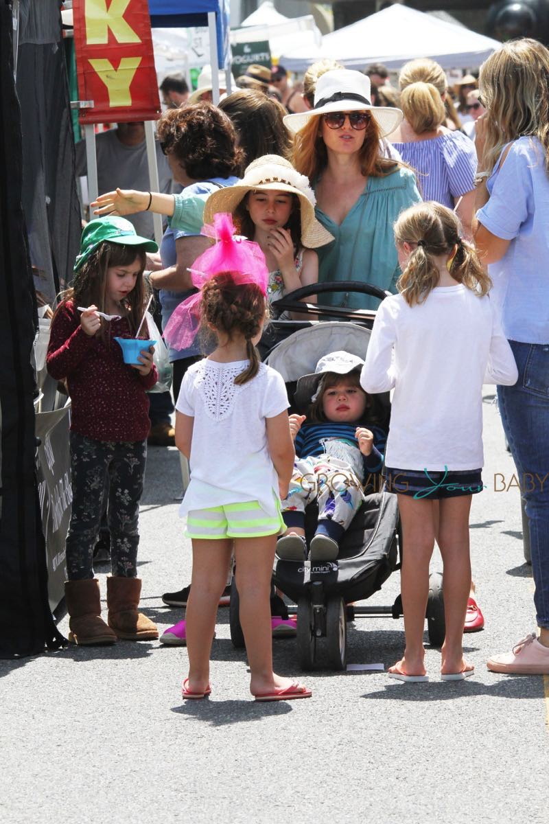 Isla Fisher shops at the Farmer's Market with her kids Olive, Elula and Monty