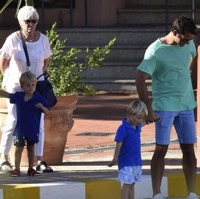 Roger Federer and his sons Leo and Lenny go on a walk in Portisco t