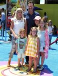 Tori Spelling and Dean McDermott at emoji movie premiere with kids Liam, Stella, Finn and Hattie