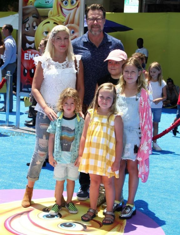 Tori Spelling and Dean McDermott at emoji movie premiere with kids Liam, Stella, Finn and Hattie