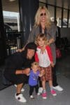 Alanis Morissette and husband Souleye take a flight out of Los Angeles at LAX with their little ones Ever and Onyx