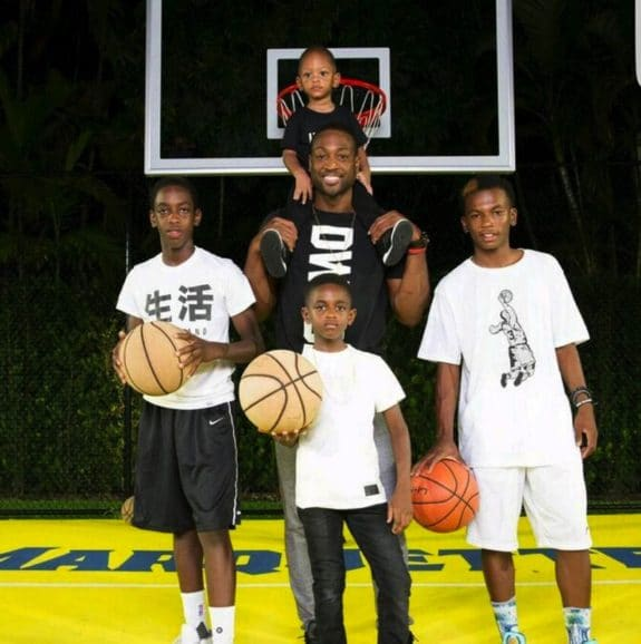 dwyane wade with sons Xavier, Zion and Zaire